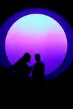 Aquarium View. Two children look through a huge round window in to an aquarium. Unusual light creates a dramatic silhouette. Monterey Bay Aquarium, Monterey royalty free stock photos