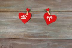 Aquarius and Aries are signs of the zodiac and heart. wooden bac royalty free stock photography