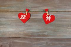 Aquarius and fish. signs of the zodiac and heart. wooden backgro. Und. card. characters. Love. unusual handwork stock image