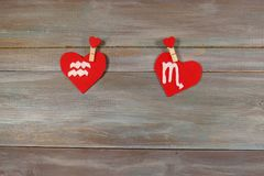 Aquarius and scorpion. signs of the zodiac and heart. wooden bac. Kground. card. Love. unusual handwork stock photo