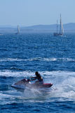 Aquascooter. Watercraft sailing with sailing to the bottom, a summer afternoon. In the Gulf of Roses, Costa Brava, Catalonia, Spain Royalty Free Stock Image