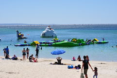 Aquatic family fun playground summer activity. Large aquatic playground in the ocean in summer for family children activity. Busselton Western Australia Stock Images