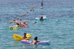 Aquatic touristic leisure summer activities. Aquatic leisure summer activities on the touristic resort beach of magaluf in the spanish island of mallorca Royalty Free Stock Images