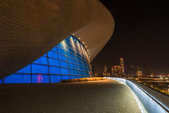 Aquatics Centre in Queen Elizabeth Olympic Park, London UK. LONDON - October 11th 2014. Night view of The Aquatics Centre in Queen Elizabeth Olympic Park. The Royalty Free Stock Photography