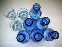 Aquavit glasses and Blue Bottles Royalty Free Stock Photo