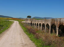 Aqueduct. Landscape with aqueduct and road royalty free stock photo