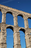 Aqueduct 3. General view of the Segovia's Roman aqueduct from the northeast, with the moon in the sky Stock Photos