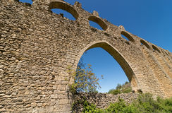 Aqueduct arch. Main arch and remaining top arches of an ancient aqueduct Royalty Free Stock Photos