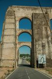 Aqueduct with arches and rectangular pillars on the road to Elvas. Architectural structure of the Amoreira Aqueduct with arches and rectangular pillars on the royalty free stock photos