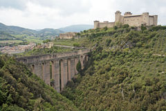 Aqueduct and castle, Italy. The Ponte Delle Torre (Bridge  of Towers) and the Rocca Albornoz, in Spoleto, Umbria, Italy. The bridge and aqueduct of 10 arches Royalty Free Stock Image