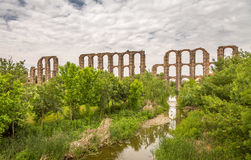 Aqueduct de los Milagros. Ruins of a Roman aqueduct bridge, part of the aqueduct built to supply water to the Roman colony of Emerita Augusta, today Mérida Stock Photo