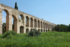 The aqueduct on a green grassy meadow g Stock Image
