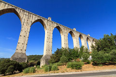Aqueduct livres Lisbon. Beautiful view of the Aguas Livres Aqueduct on a summer day in Lisbon, Portugal stock photography
