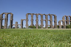 Aqueduct of Merida from the grass. Roman Aqueduct of Merida Los Milagros. Extremadura, Spain. East side Royalty Free Stock Photography
