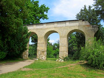 Aqueduct in the park by the Chateau in Lednice (Czech Republic). Aqueduct in the park by the Chateau in Lednice Royalty Free Stock Photos