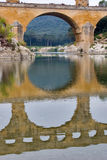Aqueduct, the river and wood. The well-known antique bridge-aqueduct Pont du Gard in Provence Stock Photography