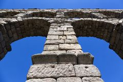 The aqueduct of Segovia, from below. Roman aqueduct in Segovia, Spain stock photography