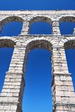 Aqueduct of Segovia. Perspective view of the aqueduct of Segovia in Spain Stock Photography