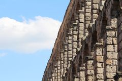 An aqueduct in Segovia, Spain. The Aqueduct of Segovia is a Roman aqueduct in Segovia, Spain. It is the foremost symbol of Segovia, as evidenced by its presence Stock Photo