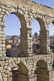 Aqueduct of Segovia, San Millan and Santiago churches behind Royalty Free Stock Photo