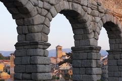 Aqueduct of Segovia, Spain. View of Segovia through the arches of its aqueduct, one of the most emblematic Roman structures in Spain. Erected in the 1st century Stock Photography