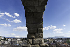 Aqueduct of Segovia, Spain. View of Segovia through the arches of its aqueduct, one of the most emblematic Roman structures in Spain. Erected in the 1st century Royalty Free Stock Photography