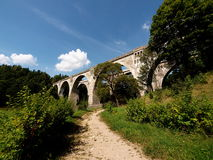 Historical railway aqueduct in Poland. Scenic view of a historical railway viaduct which was part of the Prussian railway route, pictured at Stanczyki in Royalty Free Stock Photography