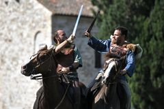 Celtic knights battle with swords riding horses Stock Photos