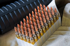 AR-15 rifle and ammo. Close-up of AR-15 rifle and ammo Stock Image
