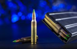 AR-15 ammo and magazine with blue background. M855 ammunition for an AR-15 with magazine on blue background Stock Photography