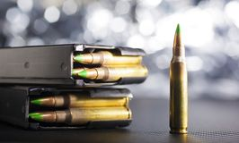 Bright AR-15 ammo. AR-15 ammunition with green tipped bullets and magazines Stock Photos