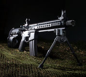 AR-15 handgun. AR-15 in a handgun configuration with green netting and dark background Royalty Free Stock Images