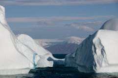 Iceberg cemetary near an Arctic fjord Stock Photography