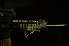 AR 15 low key. Low key shot of an AR 15 on black background Stock Image
