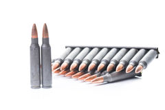 Ar15 m16 m4 kalashnikov cartridges with ammo clip isolated on wh. An image of ar15 m16 m4 kalashnikov cartridges with ammo clip isolated on white Royalty Free Stock Image