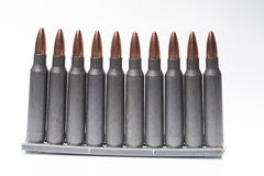 Ar15 m16 m4 kalashnikov cartridges with ammo clip isolated on wh. An image of ar15 m16 m4 kalashnikov cartridges with ammo clip isolated on white Royalty Free Stock Photography