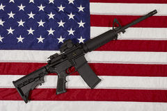 AR15 M4A1 M16 Style Weapon Automatic Rifle on USA Flag Royalty Free Stock Image