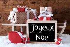 Ar met Giften op Sneeuw, Joyeux Noel Means Merry Christmas Stock Foto