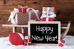 Ar met Giften op Sneeuw, Tekst Gelukkig Nieuwjaar Royalty-vrije Stock Afbeeldingen