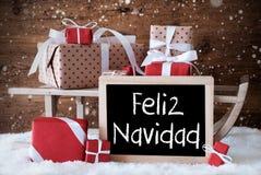 Ar met Giften, Sneeuw, Sneeuwvlokken, Feliz Navidad Means Merry Christmas Royalty-vrije Stock Fotografie