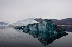 Rare blue Iceberg - Scoresbysund Fjord - Greenland Stock Photos