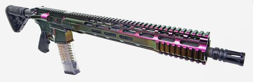 AR15 rifle painted with color changing paint. AR15 rifle painted with color changing coating, 16` barrel a clear 30rd mag loaded with visible ammo and ready to royalty free stock photos