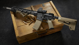 Ar15 rifle. On wood crate royalty free stock image