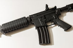 AR-15 styled rifle on a wooden table Royalty Free Stock Image