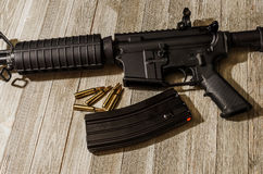 AR-15 styled rifle on a wooden table Stock Photos