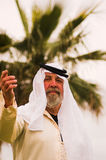 Arab. A man standing in front of a palm tree royalty free stock images
