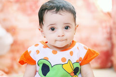 Arab baby girl. Arabian egyptian muslim baby girl with black hair Royalty Free Stock Photography