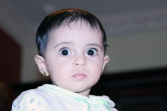 Arab baby girl staring  Stock Images