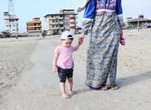 Arab baby girl with cap going to beach Stock Photography