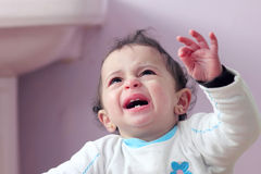 Arab baby girl crying Stock Images